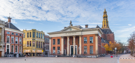 Panorama of the grain exchange building and church tower at the fish market square in Groningen, Netherlands