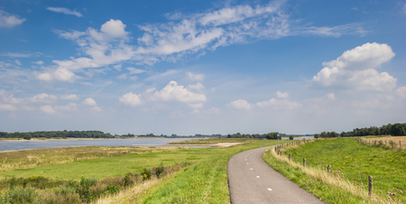 Panorama of a bicycle path along the river Waal near Zaltbommel, Holland