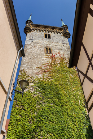 Church tower with colorful ivy in Warendorf, Germany Stock Photo