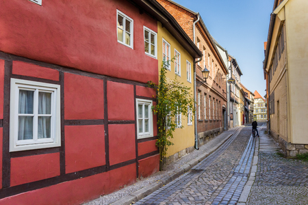 Colorful cobblestoned street in the old center of Quedlinburg, Germany