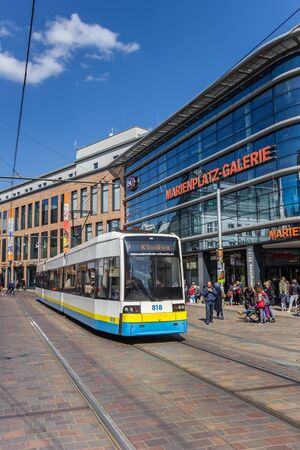 Tram in front of the shopping mall on Marienplatz square in Schwerin, Germany