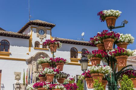 Colorful flowers in front of the town hall of Alcaudete, Spain
