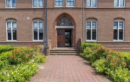 Front door of the historic monastery in Hoogeveen, Netherlands
