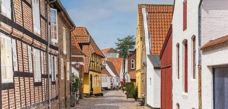 Panorama of a colorful street with historic houses in Ribe, Denmark