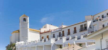 Traditional white houses and church tower in Zahara, Spain