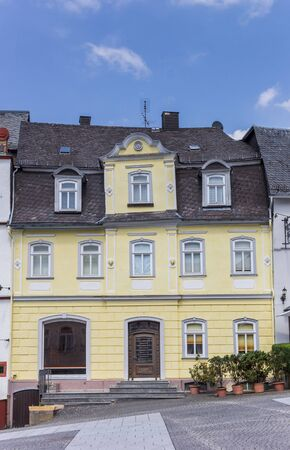 Historic yellow house at the central market square of Hachenburg, Germany