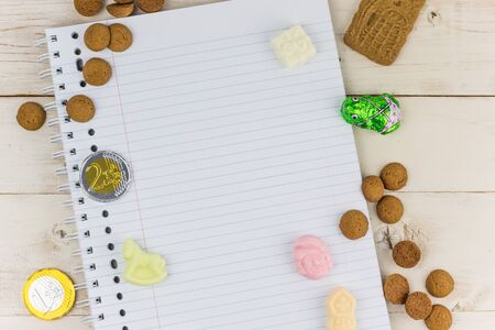 Notepad and traditional dutch candy for celebration of Sinterklaas holiday Imagens