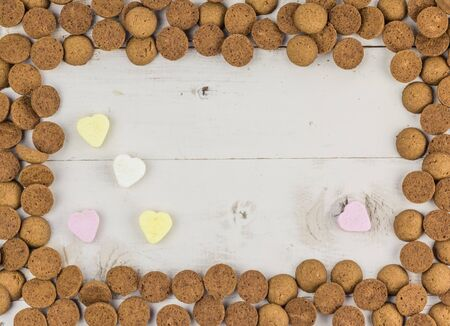 Frame of gingernuts and heart shaped candy for traditional dutch holiday Sinterklaas
