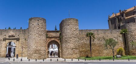 Panorama of the historic city gate of Ronda, Spain