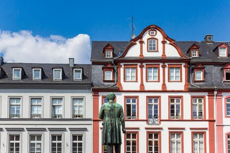 Statue and colorful facades at the Jesuitenplatz square in Koblenz, Germany