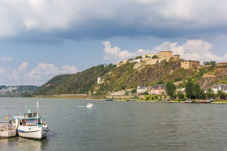 Little tourist boat at the river Rhine in Koblenz, Germany Imagens - 133497153