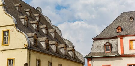 Little windows on the roof of the Burresheimer Hof building in Koblenz, Germany Imagens