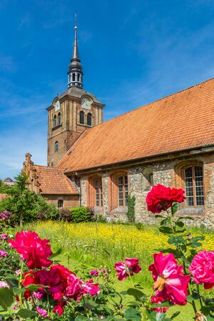 Flowers in front of the Johannis church in Flensburg, Germany