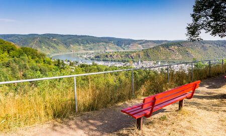 Red bench overlooking the bend in the Rhine river near Boppard, Germany