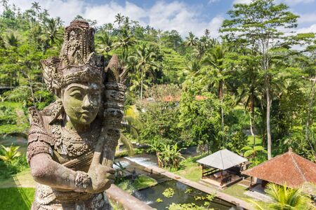 Statue on a bridge over Telaga Waja river on Bali, Indonesia Imagens