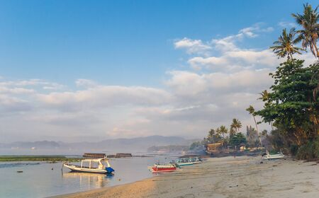 Traditional fishing boats in early morning light at the coast of Candidasa, Bali, Indonesia Imagens