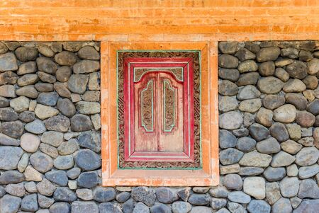 Decoration in a stone wall of a Tenganan house on Bali, Indonesia