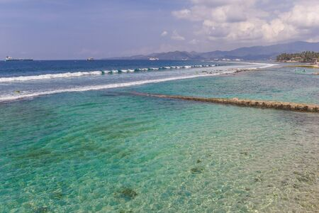Turquoise water of the Candidasa coast on Bali, Indonesia