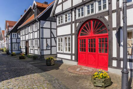 Red door in a half timbered house in Rheda, Germany Imagens