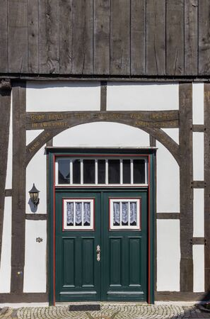 Green door in a half timbered house in Rheda, Germany