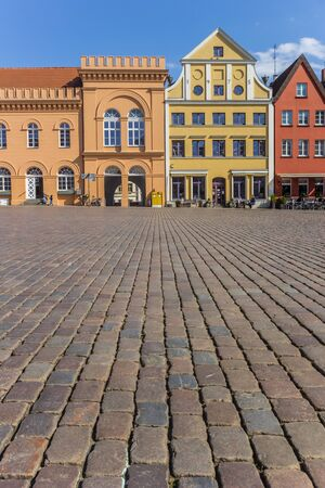 Cobblestones at the colorful market square of Schwerin, Germany Imagens