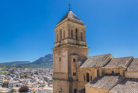 Church tower and surrounding landscape of Alcaudete, Spain Imagens