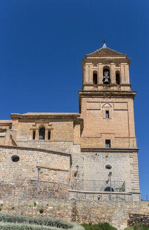 Bell tower of the Santa Maria church in Alcaudete, Spain Imagens