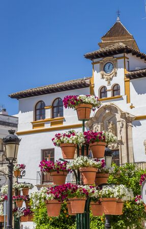 Colorful flowers in front of the town hall of Alcaudete, Spain Imagens