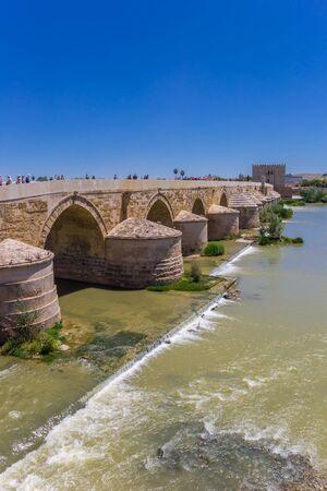 Roman bridge and city gate in Cordoba, Spain