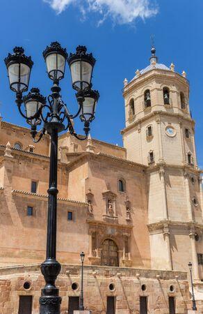 Street light and tower of the San Patricio church in Lorca, Spain