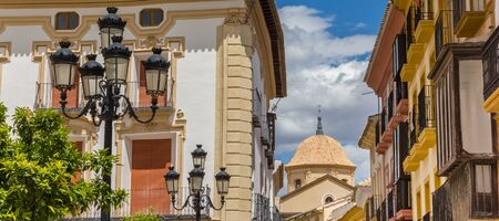 Houses and tiled church dome in Lorca, Spain