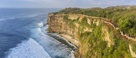 Panorama of the cliffs and ocean at the Ulu Watu temple in Bali, Indonesia Imagens