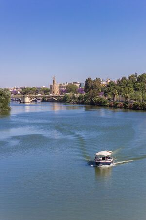 Little boat on the river Guadalquivir in Sevilla, Spain 版權商用圖片