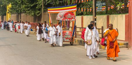 Panorama of buddhists walking in the streets of Sarnath, India