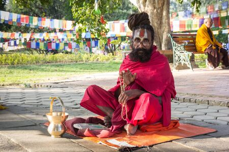Traditional monk giving his blessing at the Mayadevi temple in Lumbini, Nepal