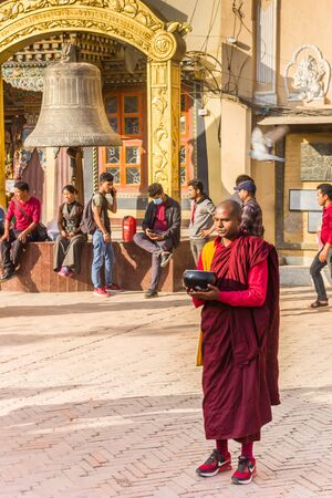 Monk in colorful clothing at the Boudhanath stupa in Kathmandu, Nepal