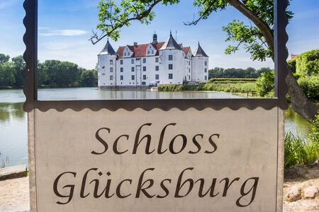 Sign with the German text 'Castle Glucksburg' in Schleswig-Holstein, Germany Stock Photo