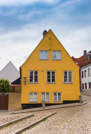 Yellow house in the cobblestoned street of Haderslev, Denmark
