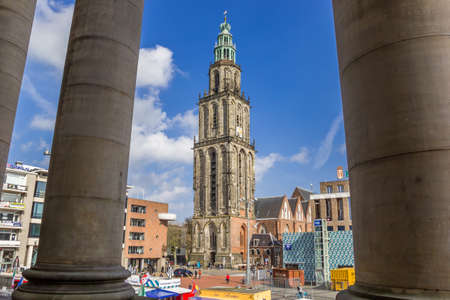 Pillars of the town hall and the Martini tower in Groningen, Netherlands Redactioneel