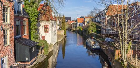 Panorama of the Damsterdiep river in the historic part of Appingedam, Netherlands 版權商用圖片