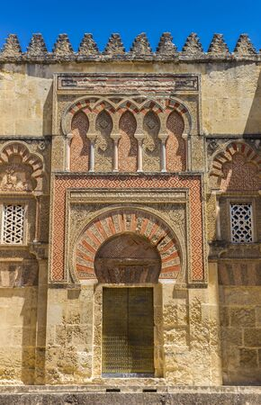 Decorated door and wall of the mosque cathedral in Cordoba, Spain