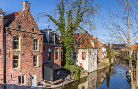 Historic houses at the Damsterdiep river in Appingedam, Netherlands