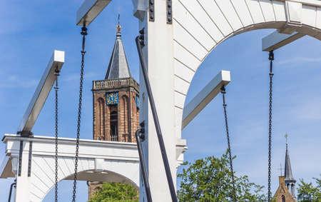 White bridge and church tower in Loenen, Netherlands