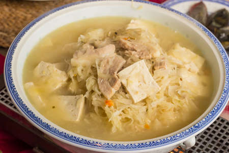 Bowl of traditional chinese sauerkraut with tofu and pork meat