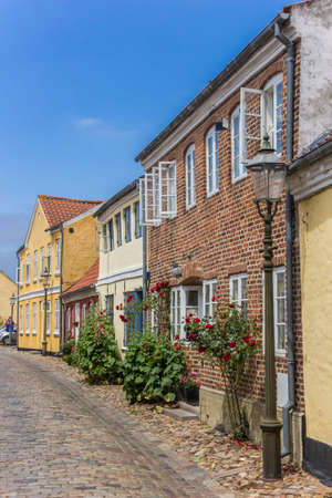 Cobblestoned street with colorful houses in Ribe, Denmark