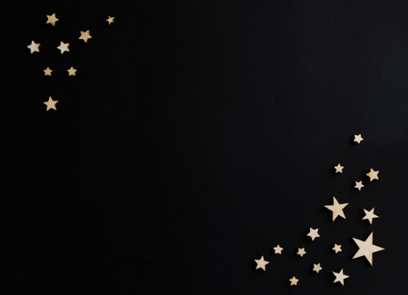 Wooden stars on a black background. Chalk board. Postcard. Dad's day concept. Men's Day. Night. Astronomy. table text space. Vintage. chalk board.