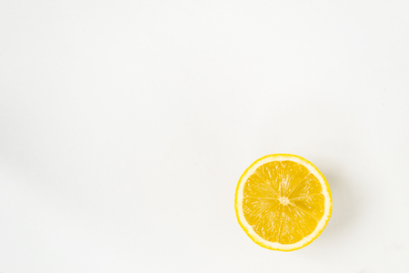 A round slice of lemon, on a white background, there is a place for text.
