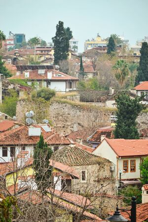 Old town Kaleici in Antalya, Turkey - travel background. Top view of the roofs of houses