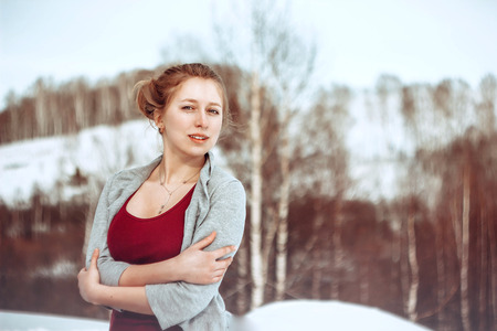 without clothes: Natural girl in winter, without make-up in revealing clothes on nature.