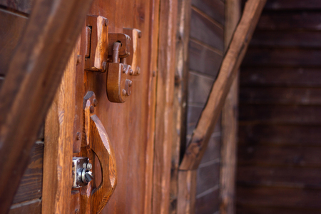 weighs: padlock wood weighs on a wooden door Stock Photo